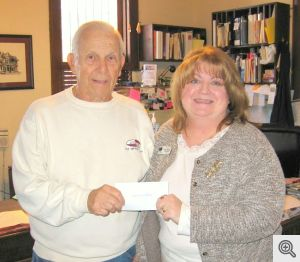 Men's Club Member Joe Lemmler presents $1000 check to Janie Smith of Jackson House